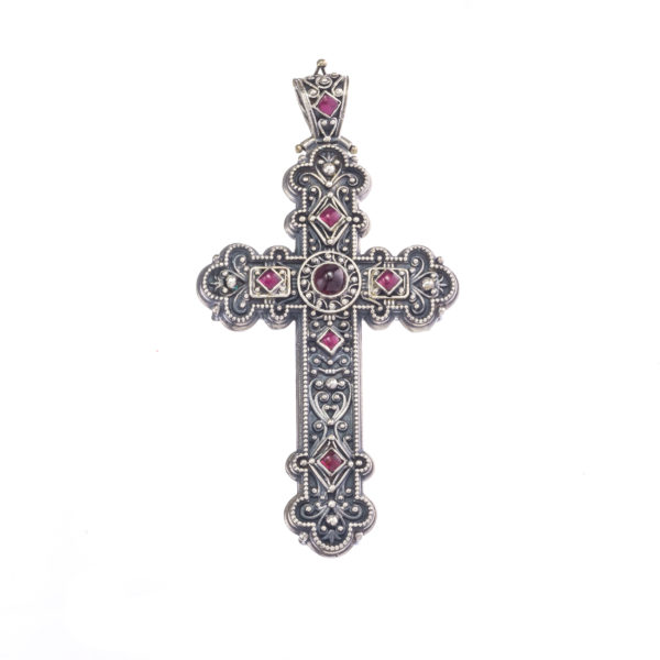 Big cross in sterling silver with garnets.