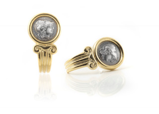 14K Gold and Silver 925 coin earrings.