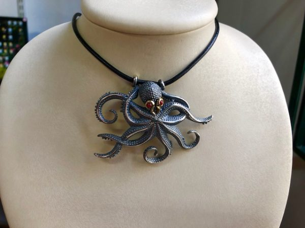 Silver 925, Gold-plated, handmade octopus pendant with Garnet stones and leather cord.