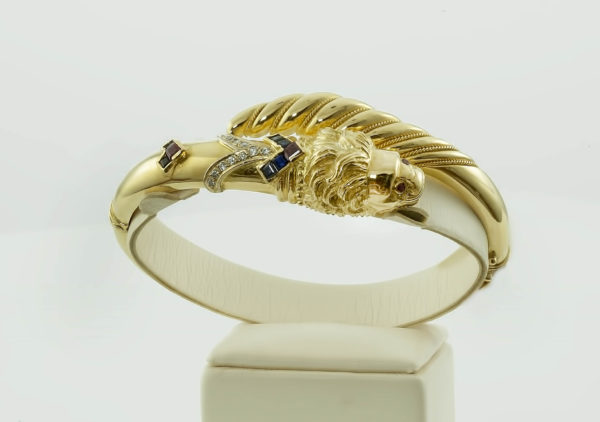 18K Gold, handmade, lion head bracelet with Diamonds, Saphires and Rubies.