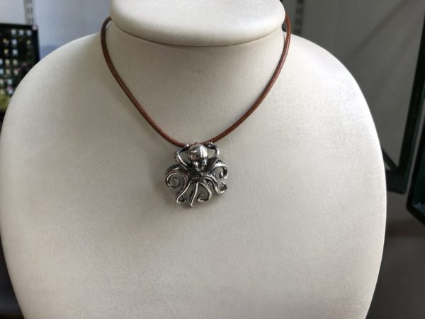 Silver 925, handmade octopus pendant with Tourmaline eyes and leather cord.