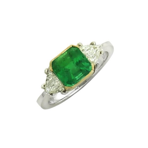 18 carat White Gold handmade Emerald and Diamonds ring.